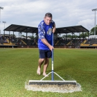American Legion World Series Volunteer Grounds Crew member Gary Spangler, squeegees the outfield of Veterans Field at Keeter Stadium, Friday, August 11, 2017 in Shelby, N.C.. Photo by Matt Roth/The American Legion.