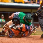 Danny Robinson of Lewiston, Idaho, Post 13 is out at home after colliding with Cam Morrison of Randolph County, N.C., Post 45 at home in game 8 of The American Legion World Series on Saturday, August 12, 2017 at Veterans Field at Keeter Stadium in Shelby, N.C. Photo by Matt Roth/The American Legion.