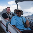 Tim Senkowski, back, laughs with commercial glider pilot Pablo Sasso-Perkins before taking off. Senkowski was given the opportunity to go on a flight in a glider as a part of an Operation Comfort Warriors grant during The American Legion's 99th annual National Convention in Truckee, Calif., on Saturday, August 19, 2017 Photo by Lucas Carter/The American Legion.