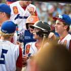 Tom Steier of Omaha, Neb., Post 1 is greeted in the dugout after scoring their first and only run against Henderson, Nev., Post 40 during the championship game of The American Legion World Series on Tuesday, August 15, 2017 in Shelby, N.C.. Henderson, Nev., beat Omaha, Neb., 2-1 becoming the 2017 ALWS Champions. Photo by Matt Roth/The American Legion.