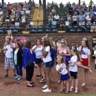Little Miss American Legion World Series Queens stand on the sideline before Idaho faces off against Arkansas during game 3 of The American Legion World Series on Thursday, August 10, 2017 in Shelby, N.C.. Photo by Matt Roth/The American Legion.