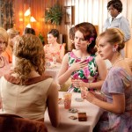 """THE HELP"" TH-026R Skeeter Phelan (Emma Stone, back to camera) makes a remark that shocks her bridge-playing friends Elizabeth Leefolt (Ahna OÕReilly, seated right), (right to left) Hilly Holbrook (Bryce Dallas Howard) and Jolene French (Anna Camp), while Aibileen Clark (Academy Award¨ nominee Viola Davis, far right) looks on, in DreamWorks PicturesÕ inspiring drama, ÒThe Help,Ó based on the New York Times best-selling novel by Kathryn Stockett. ÒThe HelpÓ is written for the screen and directed by Tate Taylor, with Brunson Green, Chris Columbus and Michael Barnathan producing. Ph: Dale Robinette ©DreamWorks II Distribution Co., LLC. ÊAll Rights Reserved."