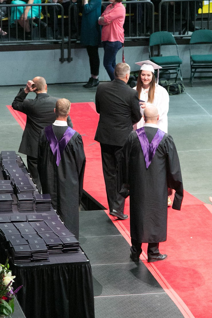 Heather Nielsen receives her diploma from Scott Carlson. Photo: Kaye Collins