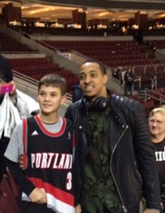 C.J. McCollum mega fan Brandon (son of Michelle Smeltz '99G) dons his new autographed jersey with C.J. after the game.