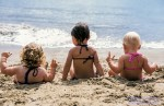 Hawaii, Kauai, 3 baby girls sitting at beach facing ocean.  MR available