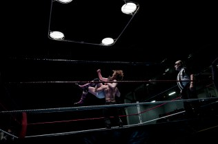 Wrestler Lord Steven Crowley, top, jumps onto Zack at the wrestling charity gala in Ivry Sur Seine, south of Paris, Saturday, Feb. 24, 2018.