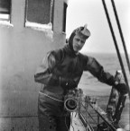Lofoten Islands, Norway, March 1959. Baldwin holding a camera in preparation for a dive in freezing waters to photograph cod fish