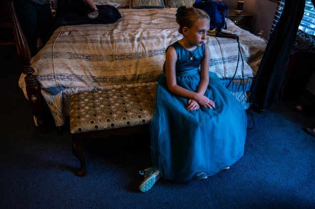 Young girl sits and waits for bridesmaids to get ready, Pilot Mountain, NC