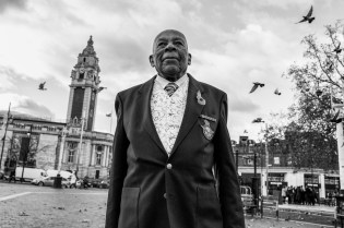 Gilbert Clark honours those who sacrificed their lives in WW2 in service of 'The mother country' at the 2017 remembrance day service in Windrush Square, Brixton, south London. Gilbert, now 93 and from Jamaica, served as a radar mechanic. Some 16,000 West Indians served in WW2 with 236 killed or reported missing. Their contribution is often overlooked.