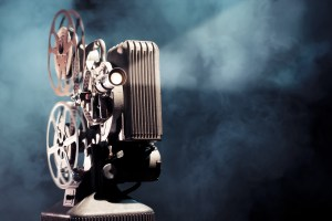 write a screenplay photo of an old movie projector