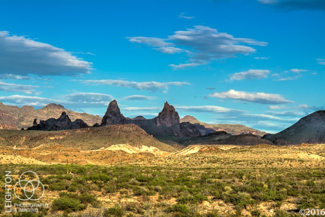 "One of the many great rock formations in the Chiso Mountains in Western Texas' Big Bend National Park and is known as the ""Mule Ear Peaks."" These twin peaks are formed from a part of a dike-like intrusion of relatively young rhyolite, and rise about 1040 feet (3,881 above sea level) above the desert floor."