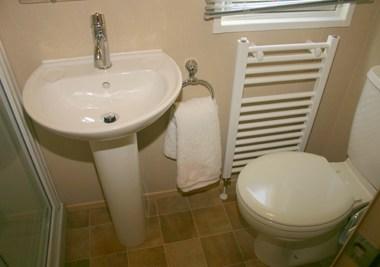 toilet is sited. Bewtween the