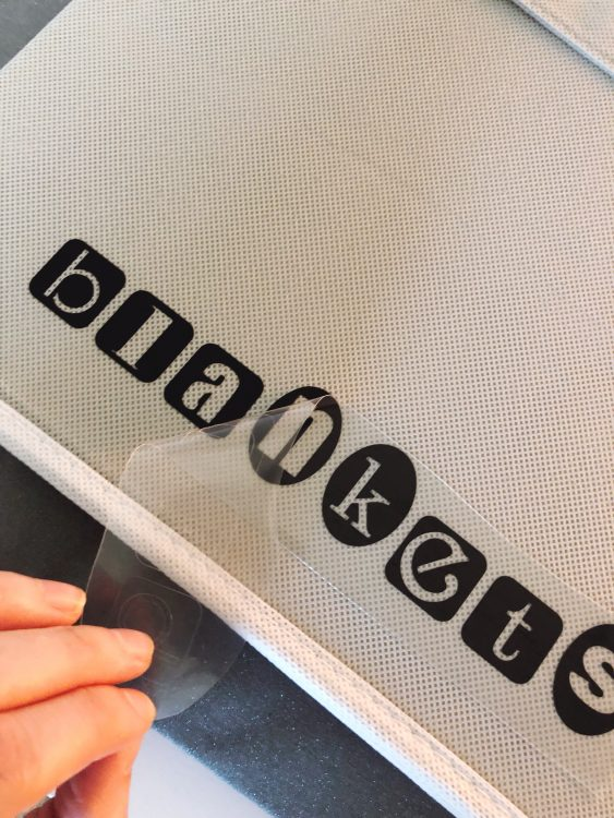 labeling fabric bins with Cricut Easy Press Iron On Transfers