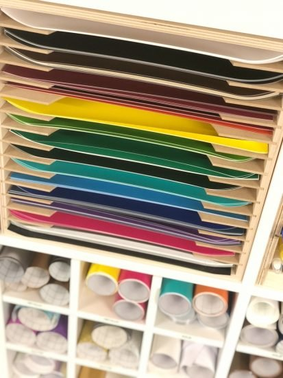 paper and vinyl craft room storage idea