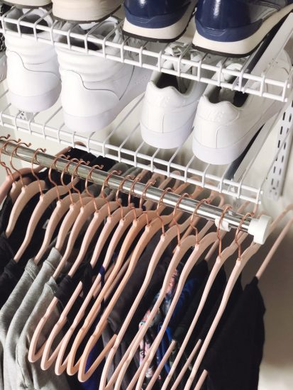 organized small closet with pink hangers