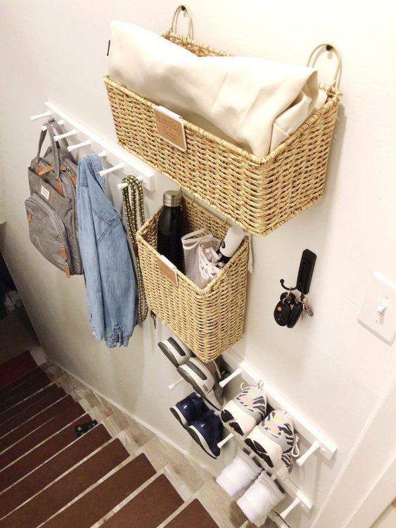 organized entryway at top of stairs