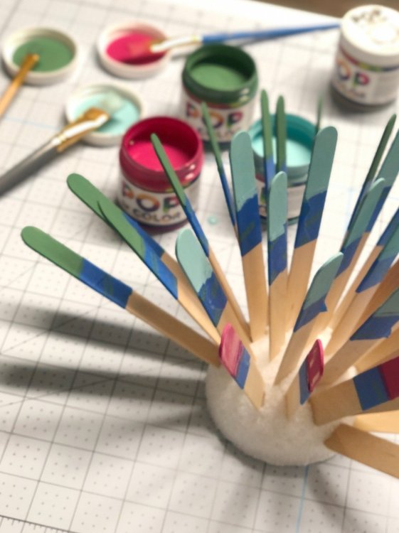 paint popsicle sticks and dry with styrofoam