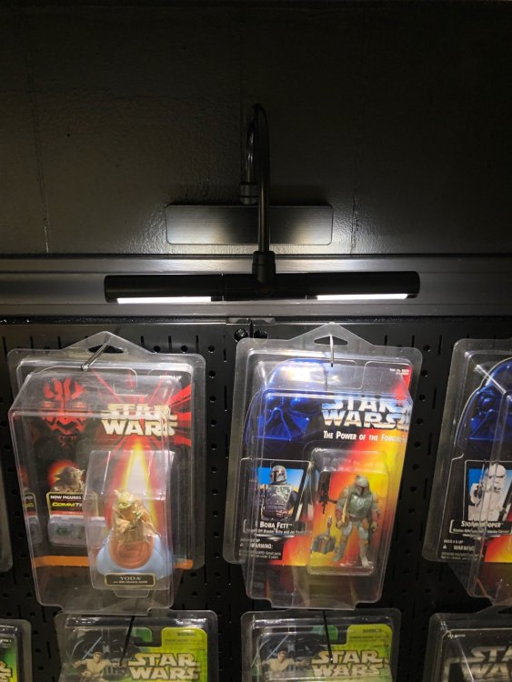 picture lighting for pegboard display wall of action figures