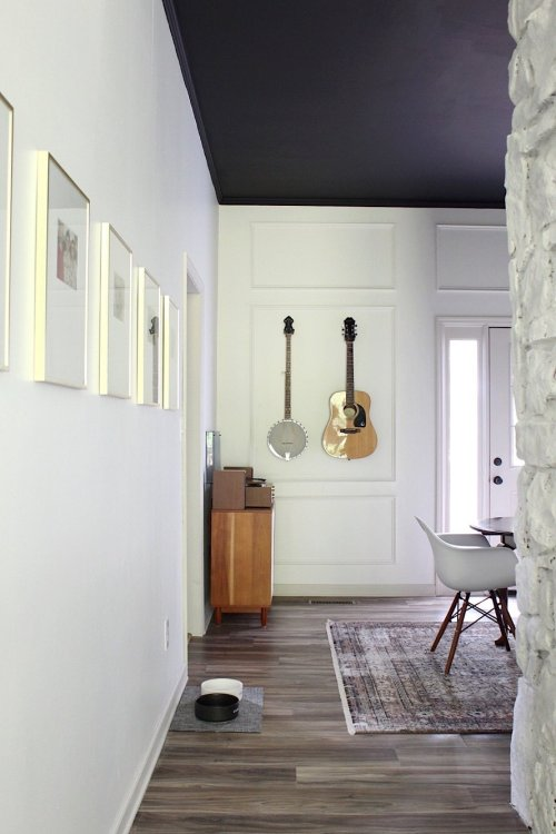 hanging guitar in dining room