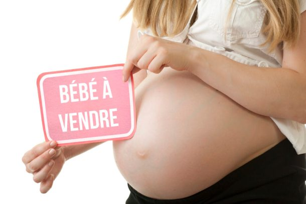 Surrogate mother. Pregnant woman with belly for sale. A baby business.
