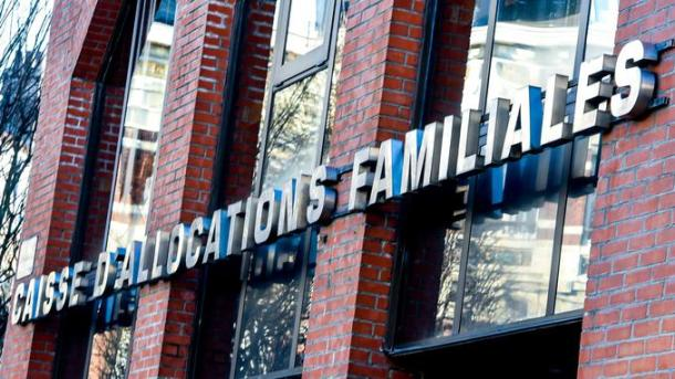 """This picture taken on February 23, 2018, shows the family benefits fund logo (""""CAF"""" Caisse d Allocations Familiales) in Lille. / AFP PHOTO / PHILIPPE HUGUEN"""