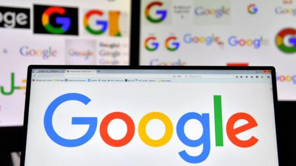 """(FILES) In this file photo taken on November 20, 2017 shows logos of US multinational technology company Google displayed on computers' screens. Google on May 4, 2018 said that people looking to place US election ads on its platform will need to show identification, and make clear who is paying.Policy changes being rolled out come as online ad 'duopoly' Google and Facebook strive to avoid being used to spread misleading or divisive ads aimed at voters.""""Our work on elections goes far beyond improving policies for advertising,"""" Google senior vice president Kent Walker said in a blog post. / AFP PHOTO / LOIC VENANCE"""