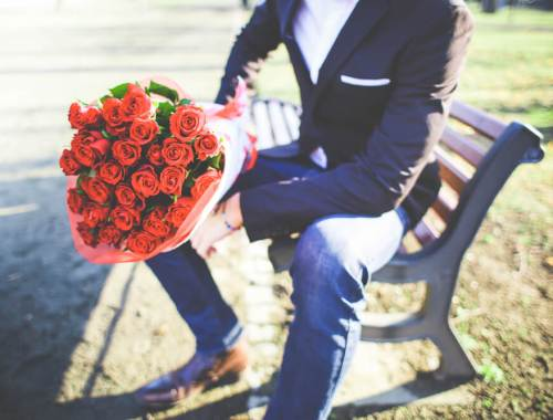 man-with-a-bouquet-of-roses-picjumbo-com