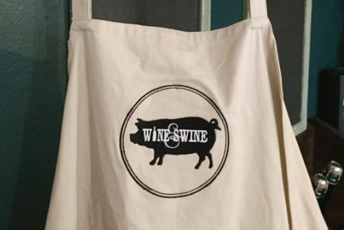 Wine & Swine apron branding
