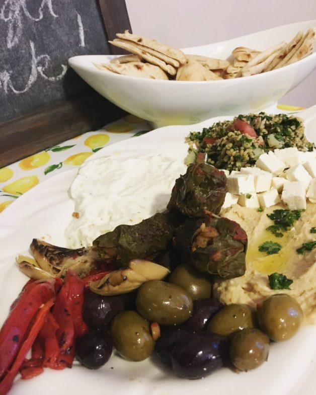 Olives, roasted peppers, hummus, tzatsiki, tabbouli, grape leaves