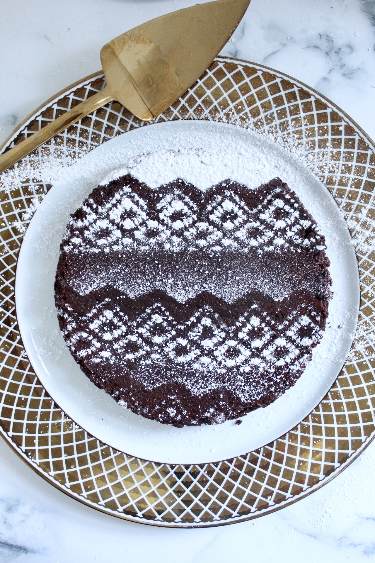 flourless chocolate cake on plate