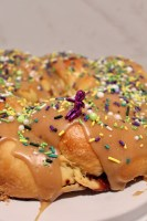 caramel king cake with purple baby on top