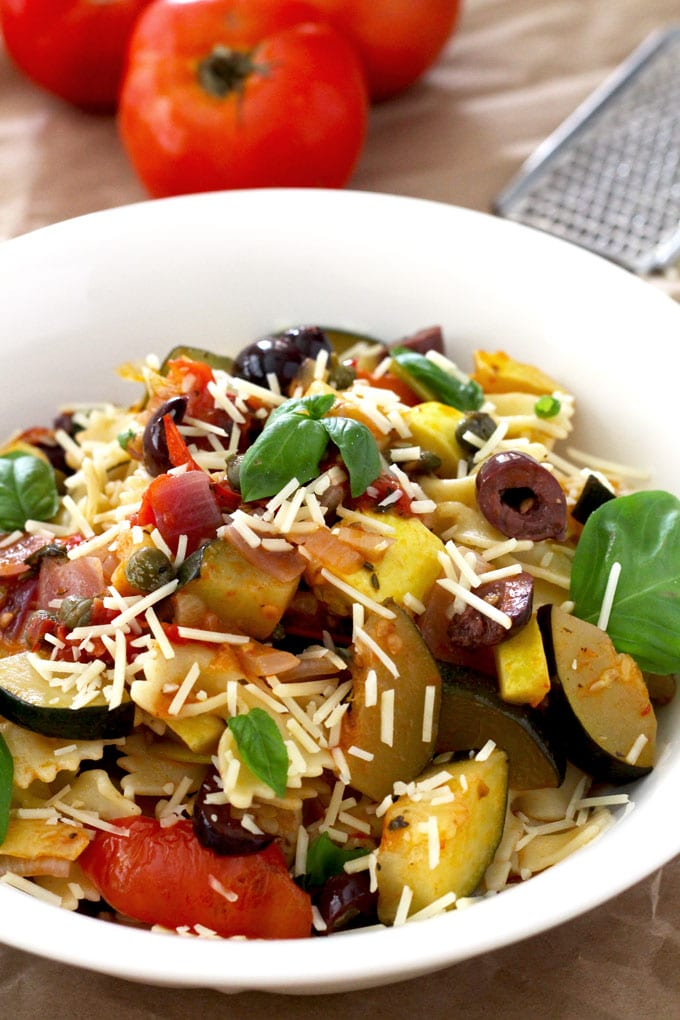 This quick and easy Pasta with Summer Vegetables is full of summer's bounty, Tomatoes, zucchini, yellow squash, Kalamata olives, capers, fresh basil and lots of Parmesan cheese make this dish irresistible!