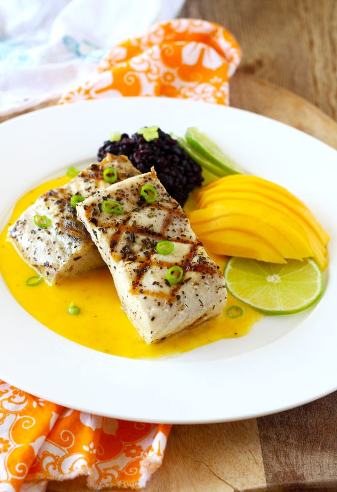 Grilled Mahi Mahi with Mango Lime Butter Sauce is easy enough for week night meals and elegant enough for special ocassions