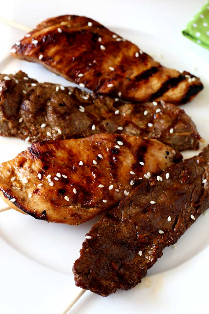 Skewered thin strips of meat are marinated in an Asian style mixture with soy sauce, sake, garlic, ginger and honey and then grilled to perfection. Serve it with rich creamy and spicy peanut sauce. You can use beef, chicken, pork or make it vegetarian with tofu. Perfect as an appetizer or as a main dish.