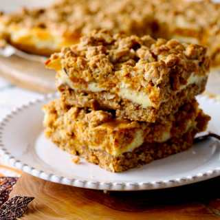 Soft and creamy these Pumpkin & Cheesecake Swirl Oat Bars are like a marriage between pumpkin cheesecake and an oatmeal cookie! Super delicious and easy to make.