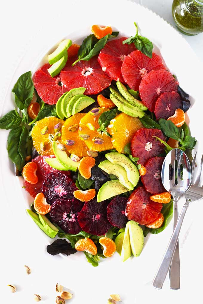 Fresh, light, healthy and easy. This citrus salad with avocado, baby spinach and arugula is tossed in a delicious basil vinaigrette and topped with pistachios for an amazing added crunch.