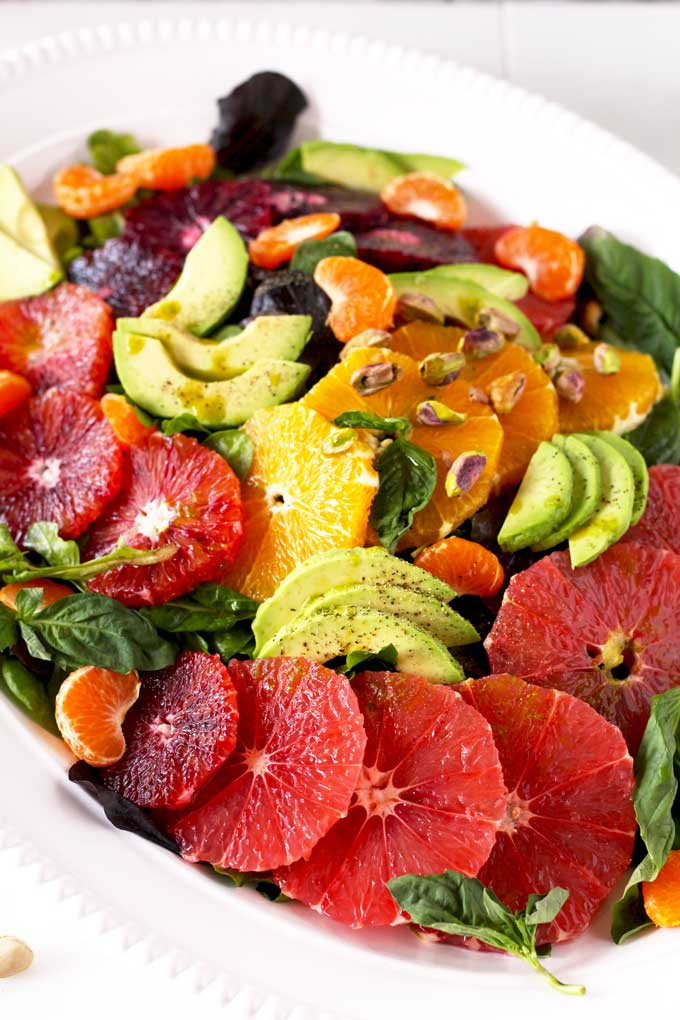 This Citrus Salad with Basil Vinaigrette is made with a blend of oranges, grapefruit, avocado and spinach tossed in a super easy to make basil vinaigrette!