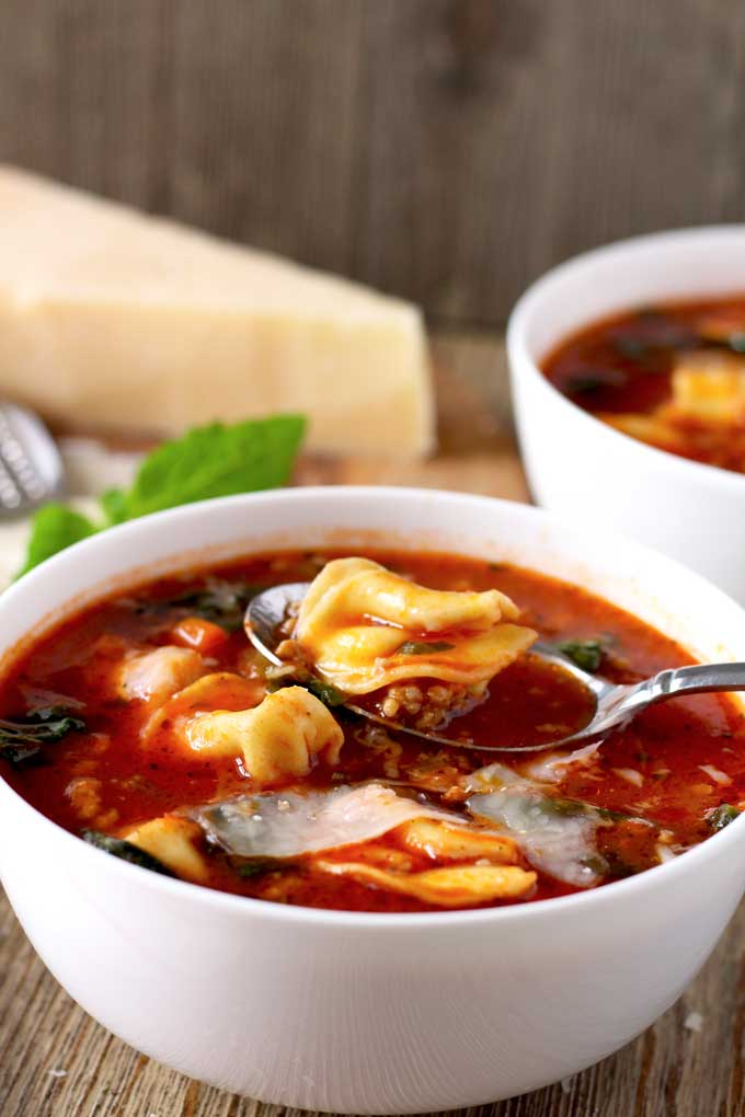 This one-pot Italian Tomato Tortellini soup is easy to make, healthy and hearty. Italian sausage, spinach and cheese tortellini make this a great and quick meal for all to enjoy.