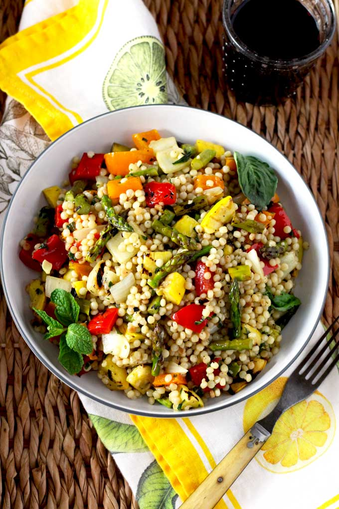Balsamic Marinated Vegetables Toasted Israeli Couscous And Fresh Herbs Are Tossed In A Simple