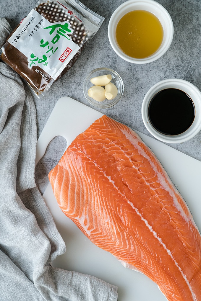 Ingredients for Miso Salmon, honey, soy sauce, garlic cloves, miso and a salmon fillet