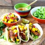 Full flavored and easy to make Blackened Fish Tacos with Mango Salsa and Sriracha Aioli. Fish fillets coated in a Cajun inspired spice mix served in warm tortillas and topped with a fresh and tasty mango salsa. Finish it up with a drizzle of creamy and spicy sriracha aioli for the best tacos ever!!!