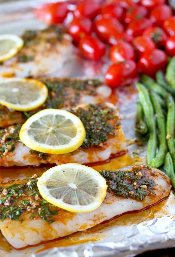 Codfillets and vegetables with chermoula sauce on a sheet pan