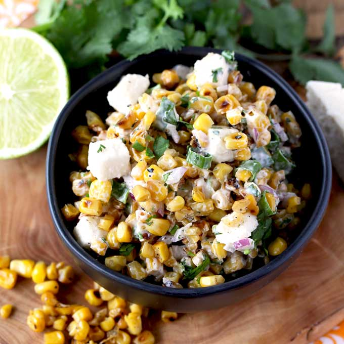 This Mexican Street Corn Salad is an easy and simple side dish inspired by street corn (Mexican Corn on the Cob). With the perfect blend of flavors - smoky, tangy and sweet with a hint of spice. This Mexican Corn Salad is always a big hit!