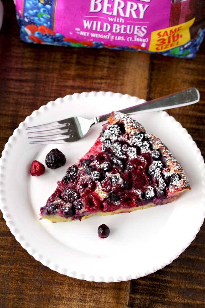 Mixed Berry Clafoutis served on a white plate
