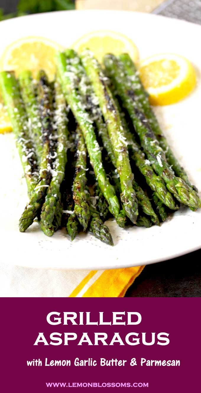 This Grilled Asparagus recipe is so easy and quick to make. Charred and smoky asparagus are tossed in simple lemon garlic butter and then topped with lots of Parmesan cheese. Asparagus on the grill has never been easier and more delicious! #recipe #grilling #sidedish #easy #healthy #asparagus #BBQ