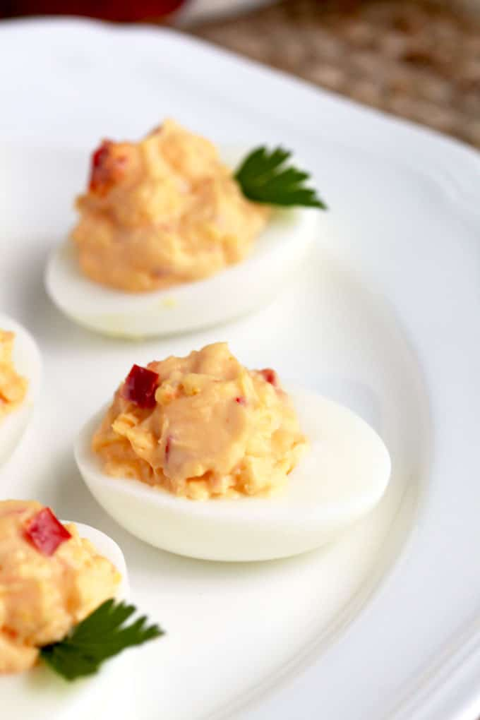 Pimento Cheese Deviled Eggs served on a white plate