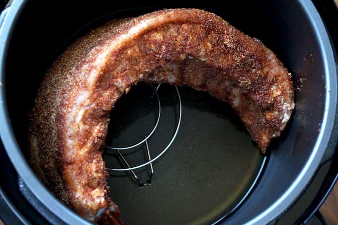 A rack of ribs inside an instant pot