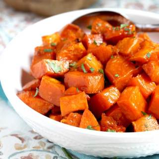 TheseOven Roasted Sweet Potatoes are coated in a tasty maple syrup mixture and oven roasted until tender, caramelized and slightly golden. This delicious side dish is easy to make any day of the week and fabulous enough to serve during the holidays!