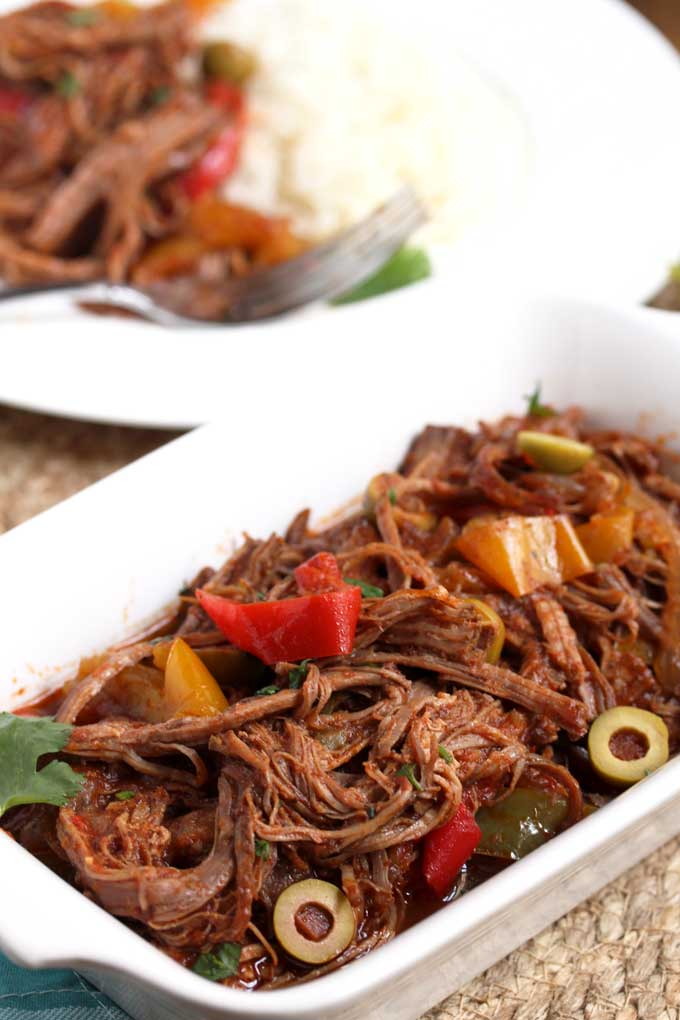 Shredded Ropa Vieja beef on a serving plate