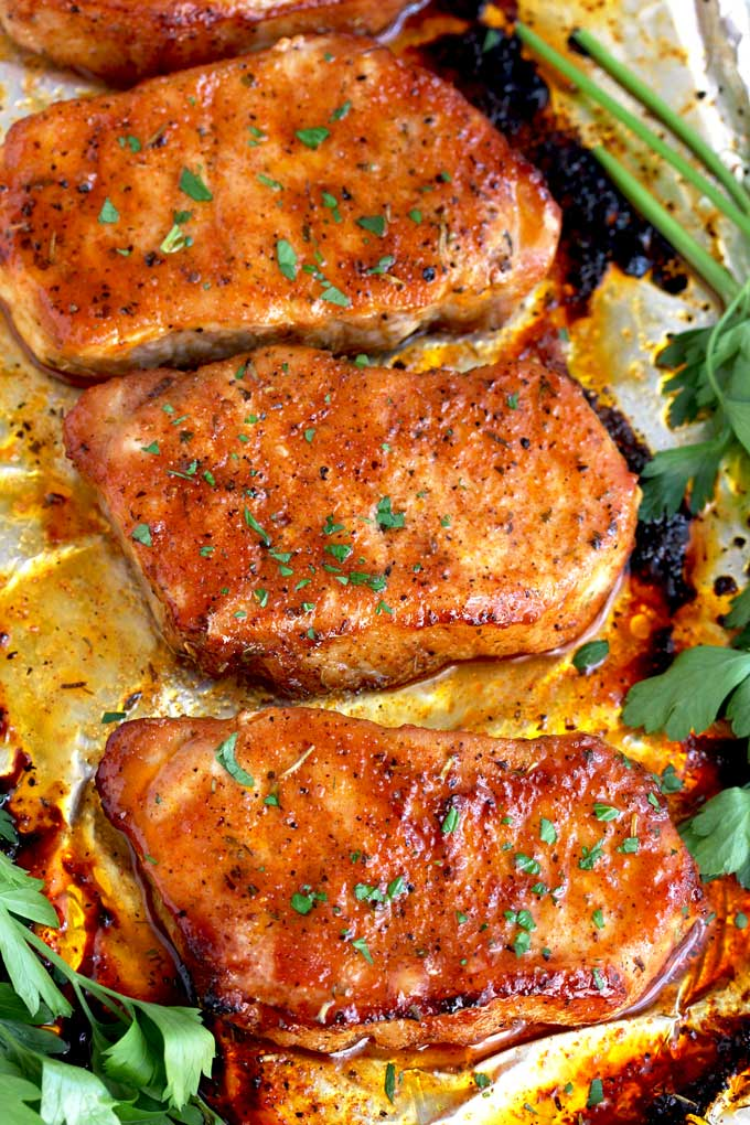 Juicy and tender Oven Baked Pork Chops on a sheet pan.